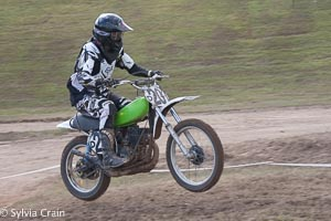 John catching some air in a relatively flat motocross track.